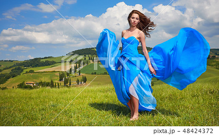 Portrait of a beauty woman in blue dress on Italy hills 48424372