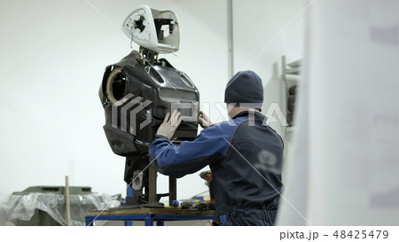 Modern Robotic Technologies. The engineer creates a modern robot or android. Production and 48425479