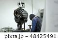 Modern Robotic Technologies. The engineer creates a modern robot or android. Production and 48425491