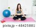 Health concept. Attractive young Asian woman sitting on mat  pra 48425881