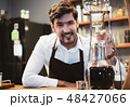 Handsome barista preparing drip coffee for customer in coffee sh 48427066