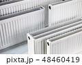 many metal radiators of different sizes  48460419