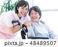 介護イメージ シニア女性と介護士 48489507