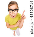 Little girl is pointing up with index finger 48508714
