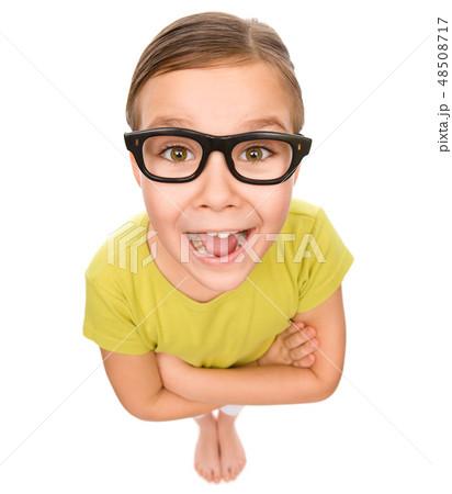 Portrait of a happy little girl wearing glasses 48508717
