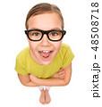 Portrait of a happy little girl wearing glasses 48508718