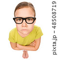 Portrait of a sad little girl wearing glasses 48508719