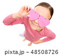 Little girl is holding hearts over her eyes 48508726