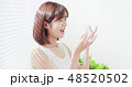 woman use oil blotting paper 48520502