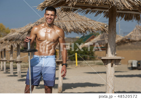 Young handsome caucasian man in shorts at the seaside 48520572