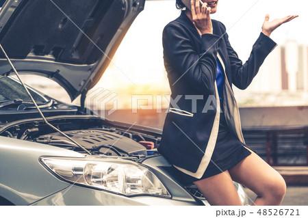 Woman whose car breakdown call for repair service. 48526721