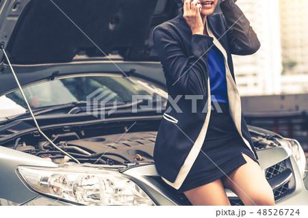 Woman whose car breakdown call for repair service. 48526724