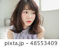 女性 ヘアスタイル 巻き髪の写真 48553409
