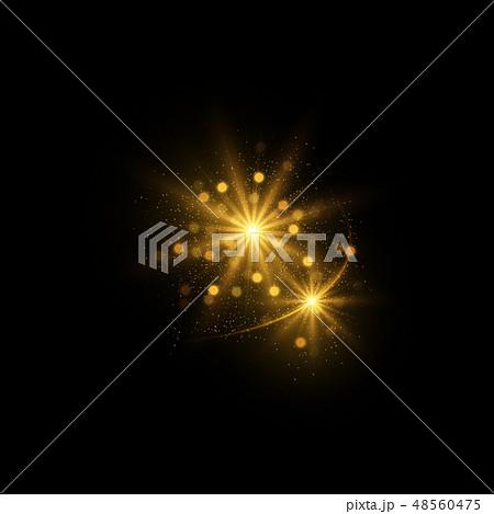 Sparkling golden magic light on black background 48560475