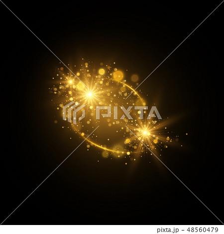 Sparkling golden magic light on black background 48560479