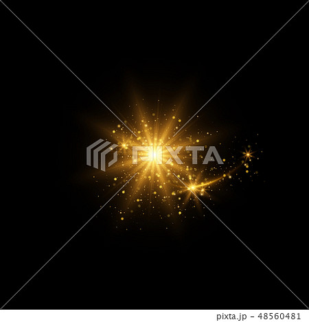 Sparkling golden magic light on black background 48560481
