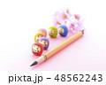 ダルマと筆と桜 48562243