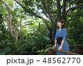 石垣島のジャングルをバックに女性 48562770