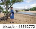 石垣島の吹通川をバックに女性 48562772