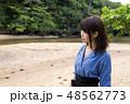 石垣島の吹通川をバックに女性 48562773