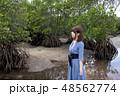 石垣島の吹通川のマングローブをバックに女性 48562774