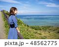 石垣島の平久保岬に立つ女性 48562775