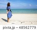 石垣島の明石ビーチの砂浜に立つ女性 48562779