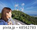 石垣島の展望台から見ている女性 48562783