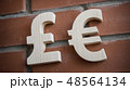 Exchange currency euro and pound on a brick wall 48564134
