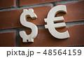 Exchange rating. Euro, Dollar on brick wall 48564159