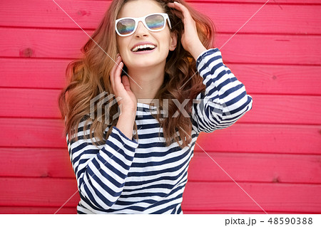Bright portrait. Pointing copy space. studio Photo of attractive young woman. 48590388