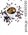 Cup with coffee beans on white background 48590590