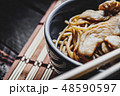 Asian noodles with chicken meat 48590597