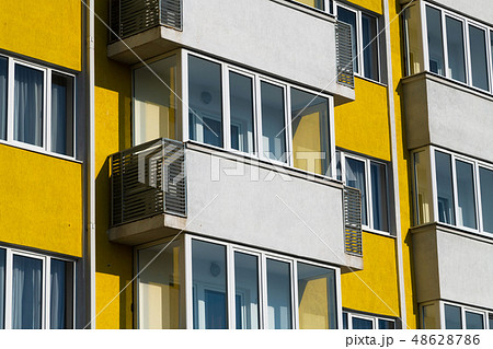 Fragment of brightly colored apartment building with balconies 48628786