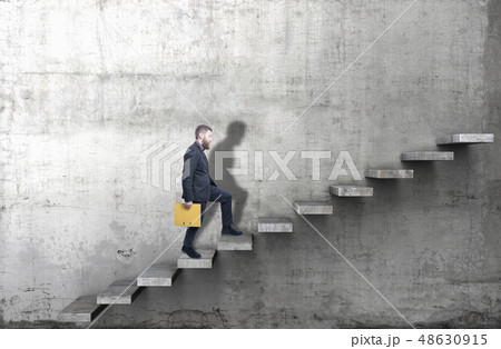 Side view of a man climbing up the steps in a blank concrete wall. 3d render 48630915