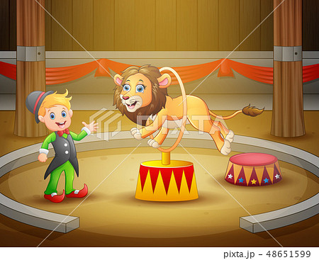 Circus trainer performs a trick along with lion in 48651599