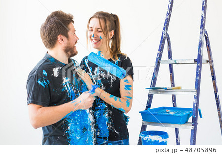 People, renovation and repair concept - Portrait of lovely couple doing redecoration in apartment 48705896