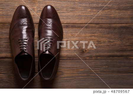 A pair of men shoes close-up on a wooden 48709567
