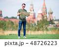 Happy young urban man in european city. 48726223