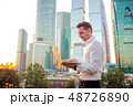 Young caucasian man holding smartphone for business work. 48726890