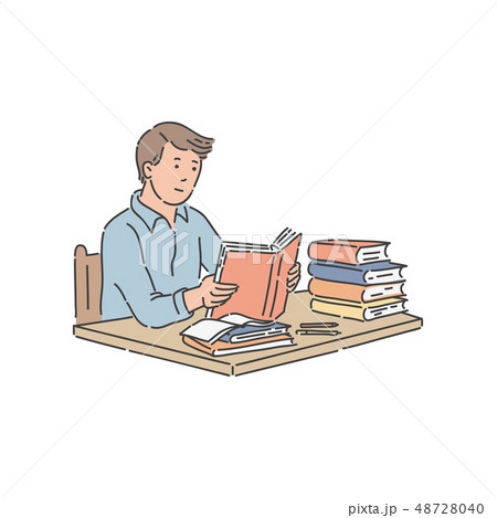 Male student sitting at table with pile of books and reading. 48728040