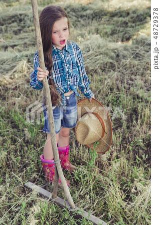 little girl in a field 48729378