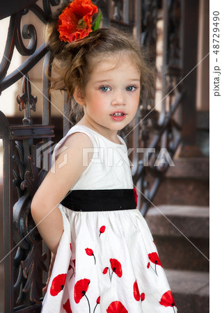 child in a dress 48729490