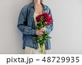 Female hands holding bouquet of peonies on white background 48729935