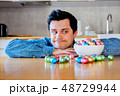 Funny man with Easter eggs 48729944