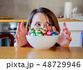 Adult woman and Easter eggs in plate  48729946