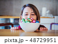 Adult woman and Easter eggs in plate  48729951