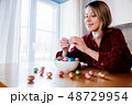 Adult woman and Easter eggs in plate  48729954