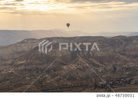 Cappadocia skyline with hot air bollon riding 48730031