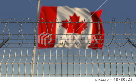 Barbed wire against waving flag of Canada. 3D rendering 48780522